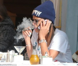 Famous vaper Christina Milian using flavour e-cigs OK E-Cigs