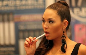 Woman using an electronic cigarette UK from OK E-Cigs