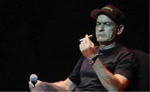 Charlie Sheen holds his e-cigarette.
