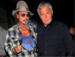 Johnny Depp pictured left, smoking an e-cigarette.